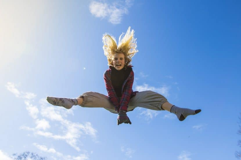 women take action and jump high into the sky