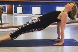 Tabitha Wright Yoga teacher at Tabitha Yoga in a reverse plank position