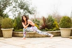 woman in a yoga pose outside in the garden yogaleggs