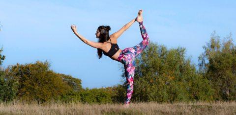 woman standing in dancers yoga pose