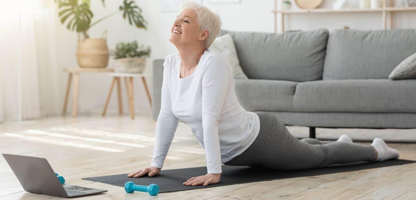 Woman practising single 1 hour premium class of yoga online